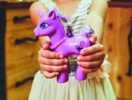 kaboompics.com Child holding unicorn toy
